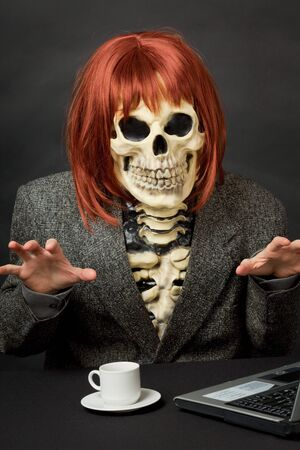 The amusing skeleton with red hair tries to frighten us