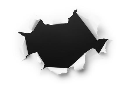 Big, dark hole in the white paper