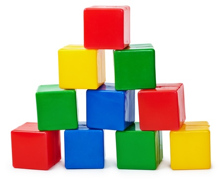 Photo pour Curve pyramid from color cubes constructed by the child isolated on white background - image libre de droit