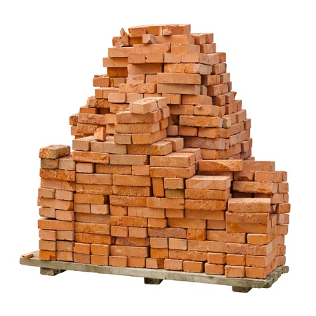 A stack of red clay bricks isolated on a white background