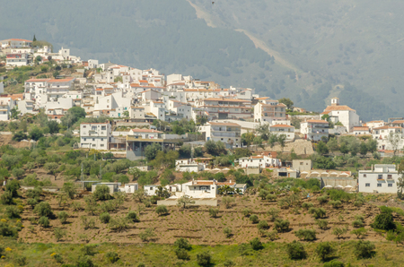 Typical Spanish village houses and farmland in the hills of Andalusia, mountain landscape