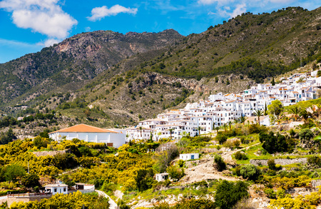 Beautiful view of the mountains in the region of Andalusia, houses and farmland on the slopes of mountains, nature