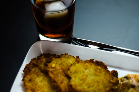 Potato pancakes with spicy stew, delicious traditional dish, Hungarian cuisine, tasty meal