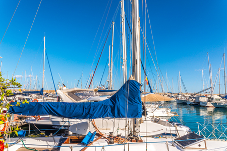 Photo for TORREDEMBARRA, SPAIN - SEPTEMBER 10, 2017   A beautiful marina with luxury yachts and motor boats in the tourist seaside town of Torredembarra - Royalty Free Image