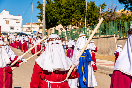 VELEZ-MALAGA, SPAIN - MARCH 27, 2018 People participating in the procession  in the Holy Week in a Spanish city, easter