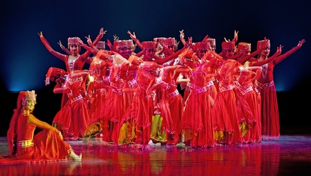 CHENGDU - DEC 15: Chinese Uigur dancers perform ethnic group dance on stage at JINCHENG theater in the 7th national dance competition of china on Dec 15,2007 in Chengdu, China.