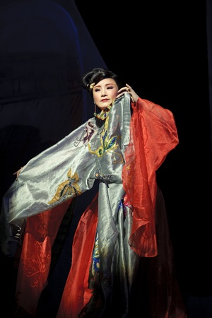 CHENGDU - MAY 31: chinese Yue opera performer make a show on stage to compete for awards in 25th Chinese Drama Plum Blossom Award competition at Experimental theater.May 31, 2011 in Chengdu, China.