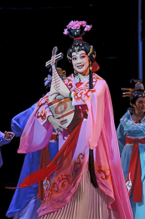 CHENGDU - JUN 6: Chinese Gaojia Opera performer make a show on stage to compete for awards in 25th Chinese Drama Plum Blossom Award competition at Jinsha theater.Jun 6, 2011 in Chengdu, China.