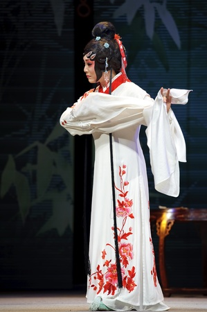 CHENGDU - JUN 4: chinese Sichuan opera performer make a show on stage to compete for awards in 25th Chinese Drama Plum Blossom Award competition at Xinan theater.Jun 4, 2011 in Chengdu, China.