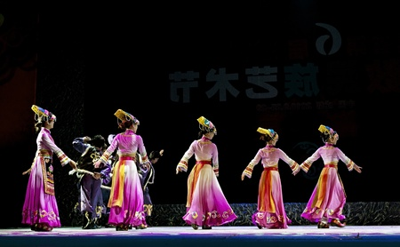 CHENGDU - SEP 28: chinese Yi ethnic dancers perform on stage in the 6th Sichuan minority nationality culture festival at JINJIANG theater.Sep 28,2010 in Chengdu, China.