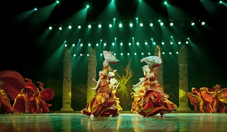 CHENGDU - SEP 26: chinese Yi ethnic dancers perform on stage at JIAOZI theater.Sep 26,2010 in Chengdu, China.