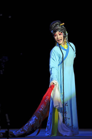 CHENGDU - JUN 4: chinese Sichuan opera performer make a show on stage to compete for awards in 25th Chinese Drama Plum Blossom Award competition at Xinan theater.Jun 4, 2011 in Chengdu, China.Chinese Drama Plum Blossom Award is the highest theatrical awa