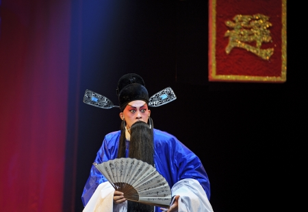 CHENGDU - JUN 5: chinese Sichuan opera performer make a show on stage to compete for awards in 25th Chinese Drama Plum Blossom Award competition at Chongzhou theater.Jun 5, 2011 in Chengdu, China.Chinese Drama Plum Blossom Award is the highest theatrical