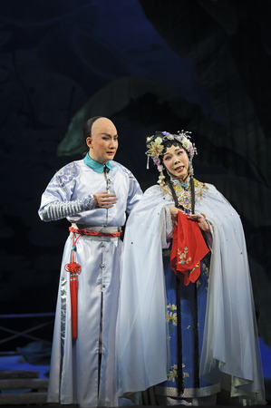 CHENGDU - JUN 3: chinese Cantonese opera performer make a show on stage to compete for awards in 25th Chinese Drama Plum Blossom Award competition at Jinsha theater.Jun 3, 2011 in Chengdu, China.Chinese Drama Plum Blossom Award is the highest theatrical
