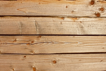 Horizontal parallel wooden old logs. Part of wooden house walls