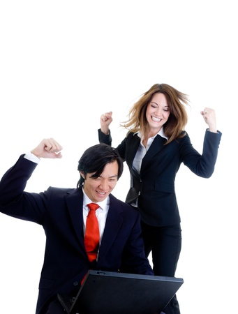Caucasian woman and Asian man in business suits, happy about something on a laptop.  Isolated on white background