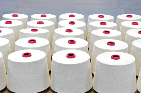 In industrial sewing machine spun yarn, many thread together