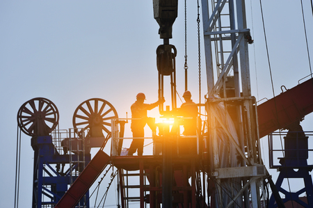 Photo for The oil workers in the job - Royalty Free Image