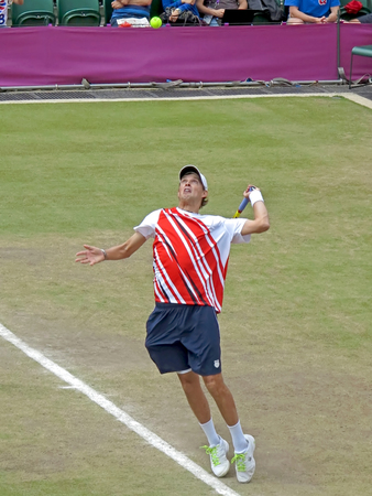 WIMBLEDON, ENGLAND - August 2nd, 2012 - Mike Bryan during one of his double matches at the summer Olympics in London in 2012. They went on to win the gold medal