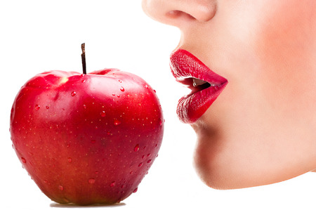Photo pour sexy woman eating red apple, sensual red lips - image libre de droit