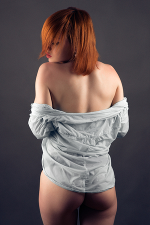 Photo pour sensual nude woman in shirt isolated on gray background - image libre de droit