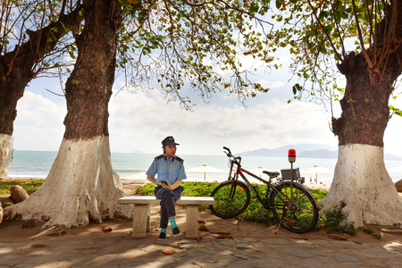 Nha Trang city, Vietnam - February 1, 2016: the security guards at Nha Trang beach regularly move patrolling by bicycle for fresh environment