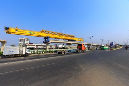 Hochiminh City, Vietnam - March 25, 2016: giant crane hoisting the beam beton up the Pillars, prepare for subways lines