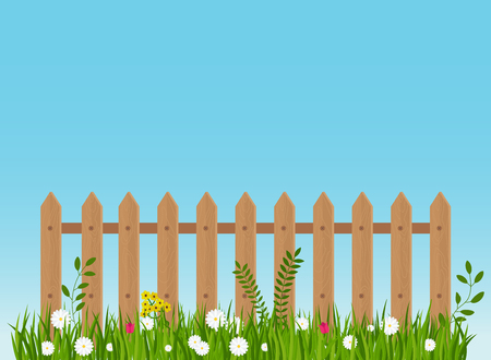 A Wooden Fence A Hedge Near With A Flower Bed Royalty Free