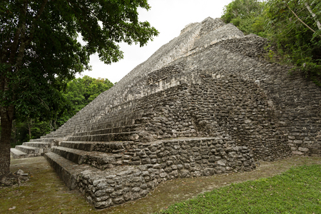 Mayan pyramid surrounded by tropical jungle at the archaeological site Becan,Mexico
