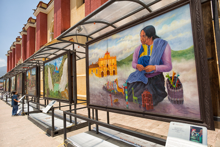 April 14, 2014 San Cristobal de las Casas, Mexico: informative explanatory street frescos depicting the rich indigenous history, traditions and culture of the area
