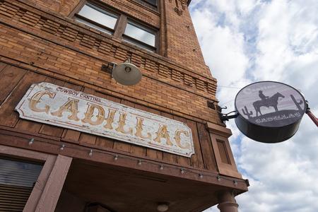 Foto für December 25, 2015  Fort Worth, Texas, USA: the Caillac Cantina restaurant store front in a historic centennial building at the Stockyards - Lizenzfreies Bild
