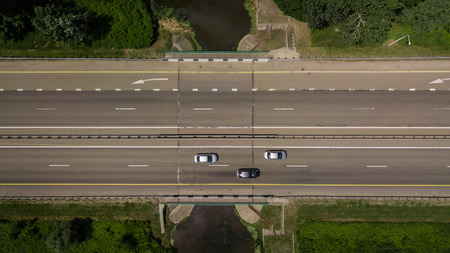 Photo for Top down close up of highway traffic, white arrow signs indicating direction - Royalty Free Image