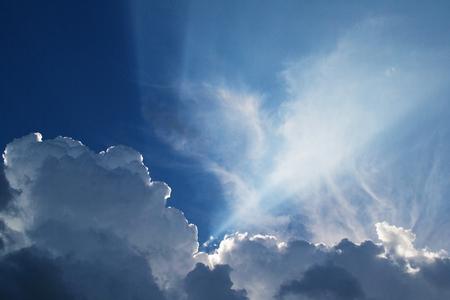 Foto de Beautiful clouds feathers against the blue sky, consecrated by the sun, background for design. - Imagen libre de derechos
