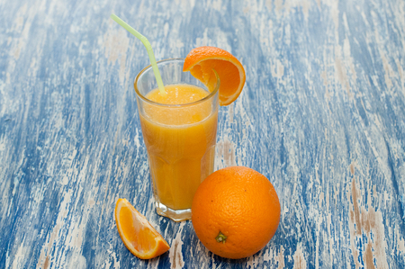 Photo for Orange juice cocktail in a glass with a straw - Royalty Free Image