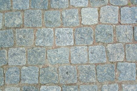 Photo for Old aged granite paving stones. Texture of old granite paving stones. The texture of the pavement granite pattern wallpaper for design. Rough texture  - Royalty Free Image