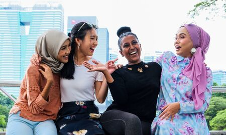 Photo pour Group of happy women of different races and religion living together in harmony - image libre de droit