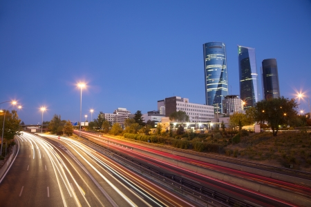 evening at highway next to skyscrapers in Madrid city Spain