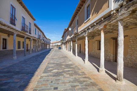 medieval street, with arcaded buildings, landmark and monument from seventeenth century, in Ampudia village, Palencia, Castile Leon, Spain, Europe