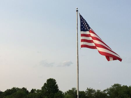Photo pour american flag big waving in wind with sky - image libre de droit
