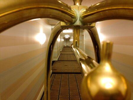 Photo pour Hotel hallway long perspective corridor symmetrical design with bellhop cart - image libre de droit