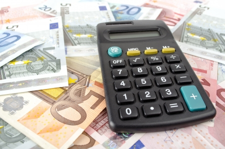 calculator and euro banknotes abstract business background