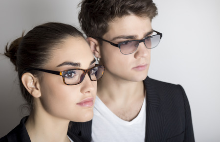 young couple with glasses close up portrait
