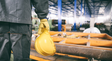 Photo for worker with protective uniform in production hall  - Royalty Free Image