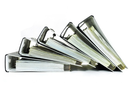 Pile of office ring binders with tax documents