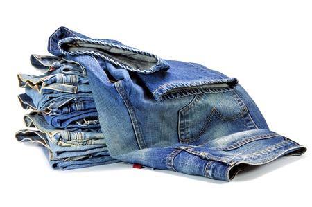Foto de Blue denim jeans isolated on white - Imagen libre de derechos