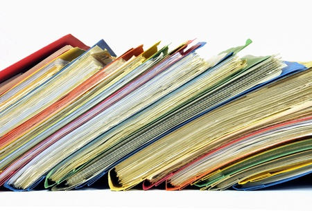 Row of multicolored folders with documents on white background