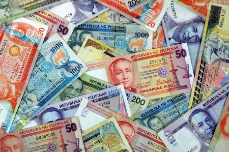 Stack of various Philippine banknotes