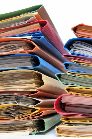 Foto de Two stacks of colorful folders over white background  - Imagen libre de derechos