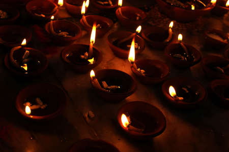 Photo for celebration of diwali clay oil lamp spreading light - Royalty Free Image