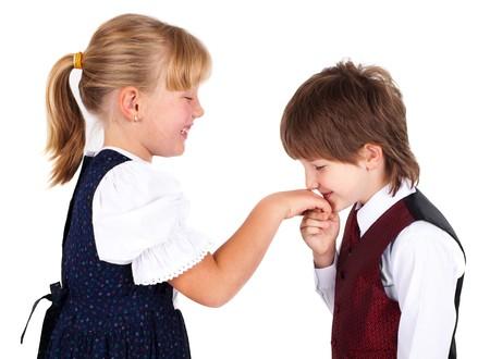Photo pour Little boy kissing hand, isolated on white background - image libre de droit